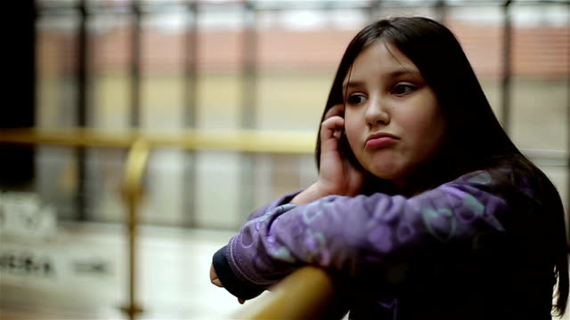 little girl talking with phone video
