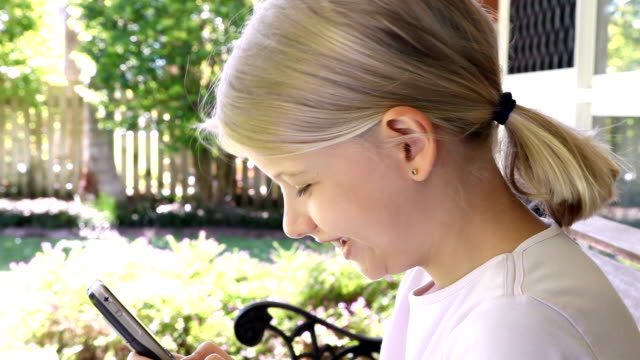 Little Girl Texting on her mobile cell phone video