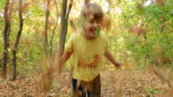 Little girl throws up autumn leaves video