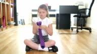 Little Girl Ties her School Tie video