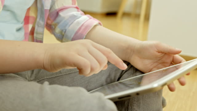 Little Girl Using A Digital Tablet video