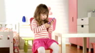 HD DOLLY: Little Girl Using A Mobile Phone video