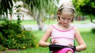 Little girl using ipad tablet computer video