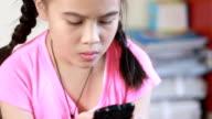 Little girl using mobile phone video