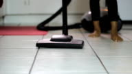 Little Girl Vacuuming Kitchen Floor-Low Angle video