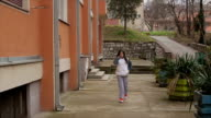 Little girl walking and talking with smart phone video