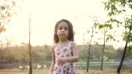 Little girl walking in the garden video