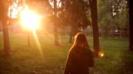 little girl walks in the park in autumn video