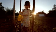 HD IMAGE SEQUENCE. Little Girl Watering Organic Tomatoes,Sunset,Rural Scene video