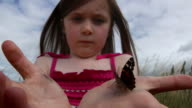 Little girl with butterfly - 720p video