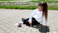 Little girl with colorful chalks video