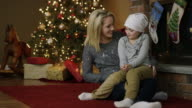 Little girl with leukaemia cancer at Christmas with mother video