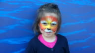 Little girl with lion face painting roaring like a lion video