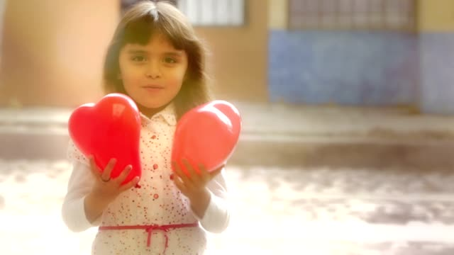 Little girl with red balloons video