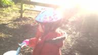 Little GirlCycling Through A British Park video