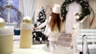 Little girl-elf with a magic wand runs into the room on Christmas Eve video
