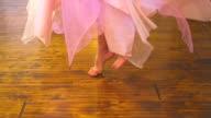 Little girls feet spinning video
