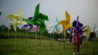 Little girls playing with a toy windmill in the field / Chiang Rai, Thailand video