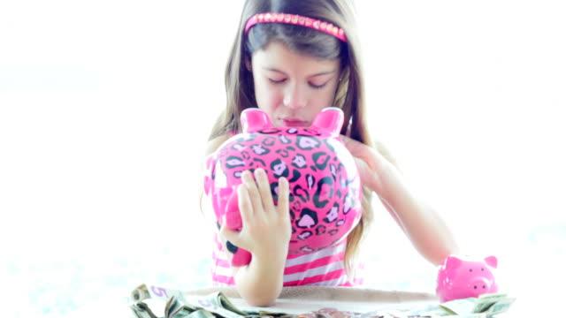 Little girls searching her piggy bank video