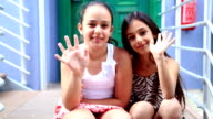 Little girls smiling to a camera video