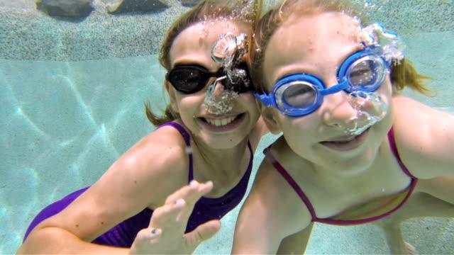Little Girls Swimming Under Water video