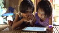 Little girls using tablet video