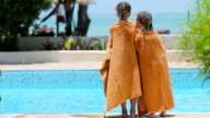 Little girls wrapped in towel after swimming video