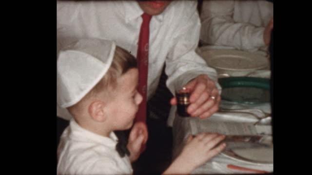 Little Jewish Boy drinks wine at Passover seder video