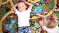Little kids lying on the floor. Dream video