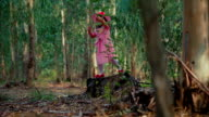 Little princess in the forest standing on stump video