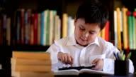 little school boy using digital tablet video