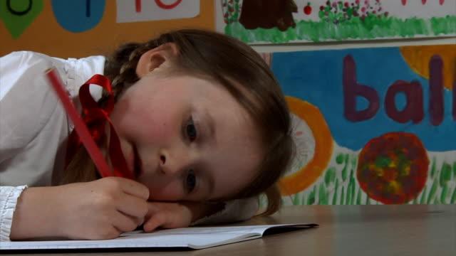 Little school girl writing video