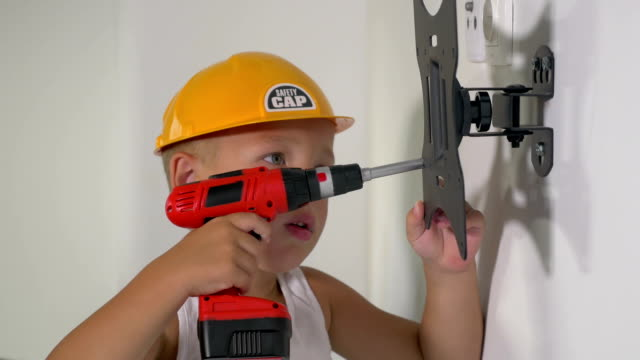Little service man with toy screwer video