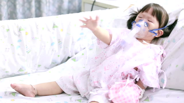 Little sick girl with oxygen mask video