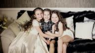 Little sisters hugging. video