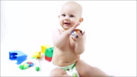 Little smiling baby. Child playing with color blocks. video