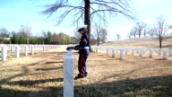 Little Soldier Laying Flag On Grave video