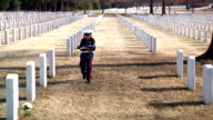 Little Soldier Visiting Grave Site of Father video