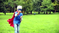 Little Superhero fighting in the park. video