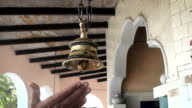 Little swinging bell in the Hindu temple video