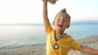 Little Winner Boy with Medal and Cup video