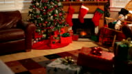 Living room decorated for Christmas, jib up video