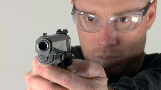Loading and aiming 45 pistol video
