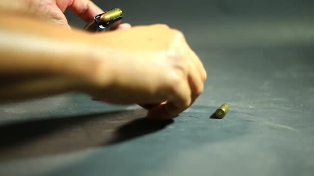 Loading bullets in handgun clip video