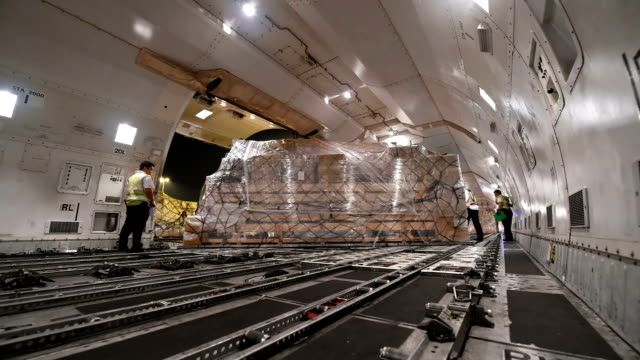 Loading cargo inside cargo aircraft video