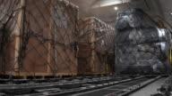 4K: Loading cargo inside cargo aircraft video