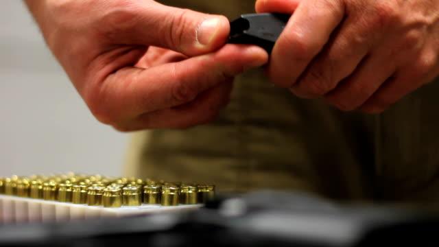 Loading handgun. Pistol and bullet. video
