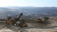 Loading of iron ore on very big dump-body truck video