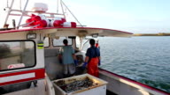 Lobstermen Talk as They Head Out to Sea, Maine video