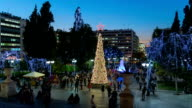 Local people and tourists walking at decorated for Christmas Syntagma. video